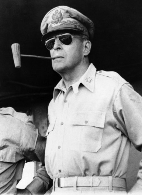 Douglas MacArthur smokes one of his favorite corn cob pipes on a ship bound for Luzon Island in the Philippines on January 20, 1945. Five Star Insignia on his collar denoting him general of the Army. (Photo by AP Photo/Pool)