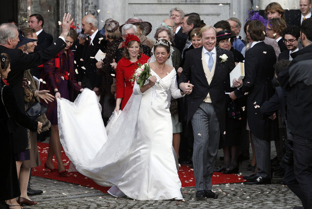 Prince Carlos of Bourbon-Parme, nephew of Netherlands' Queen Beatrix, and Annemarie Gualtherie van Weezel leave the church after their wedding at the Ter Kameren Abbey in Brussels, November 20, 2010. (Photo by Sebastien Pirlet/Reuters)