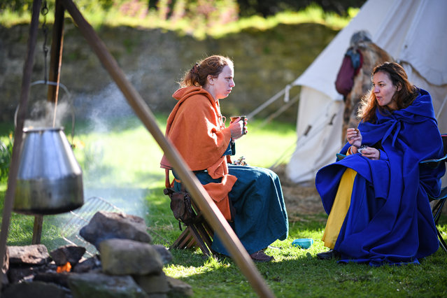 Competitors take a break during the International Medieval Combat Federation World Championships at Scone Palace on May 10, 2018 in Perth, Scotland. (Photo by Jeff J. Mitchell/Getty Images)