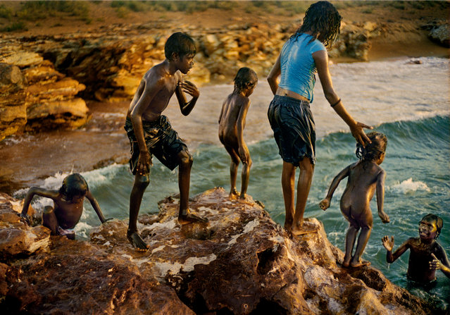 Children Cooling Off at Dhiari Homeland. Local children get wet and cool in Arnhem Land. (Photo by Matthew Abbott/Australian Life Prize 2015)