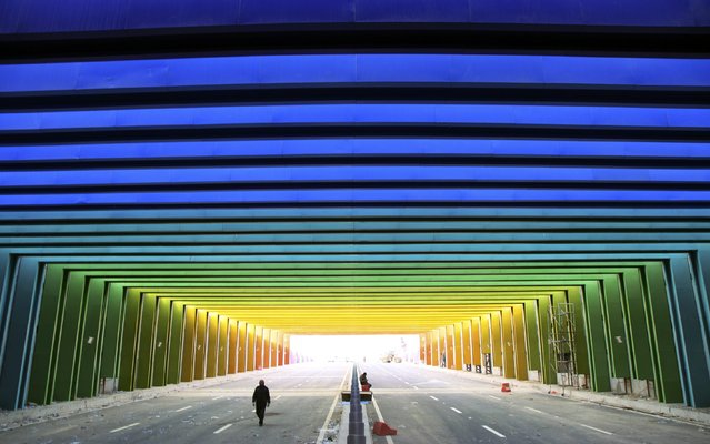 A man walks along a newly-built tunnel, consisting of rainbow colours, in Zhengzhou, Henan province January 13, 2015. The 400-metre-long tunnel is the first of this kind in China, local media reported. (Photo by Reuters/Stringer)