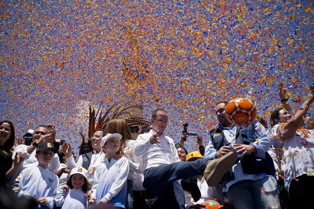 Presidential candidate Ricardo Anaya, of the left-right coalition Forward for Mexico, kicks a soccer ball to supporters under falling confetti during his campaign rally in Mexico City, Sunday, June 24, 2018. Mexico's four presidential candidates are holding their last weekend of campaigning before the country's July 1 elections. (Photo by Ramon Espinosa/AP Photo)