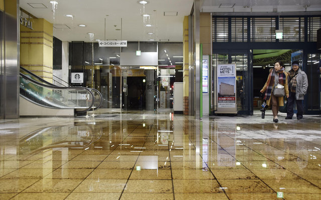 Water covers a floor of Fukushima station as it leaks from a ceiling following an earthquake in Fukushima, northeastern Japan Saturday, February 13, 2021. A strong earthquake hit off the coast of northeastern Japan late Saturday, shaking Fukushima, Miyagi and other areas, but there was no threat of a tsunami, officials said. (Photo by Kyodo News via AP Photo)