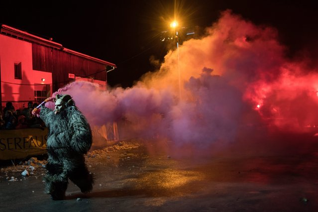 A person dressed as the Krampus performs during the 9th Krampus meeting show in Serfaus, Tyrol, Austria, 12 November 2016. (Photo by Christian Bruna/EPA)