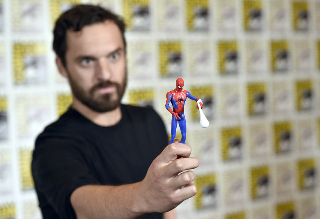 """Jake Johnson holds a figurine of Spider-man at the """"Spider-Man: Into the Spider-Verse"""" press line on day two of Comic-Con International on Friday, July 20, 2018, in San Diego. (Photo by Chris Pizzello/Invision/AP Photo)"""