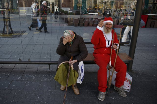 A man dressed as Santa Claus sits at a bus stop before an annual race in Belgrade, Serbia December 27, 2015. (Photo by Marko Djurica/Reuters)