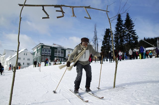 """A participant competes in the """"Nostalgic Ski Race"""" in the western town of Neuastenberg February 8, 2015. (Photo by Ina Fassbender/Reuters)"""