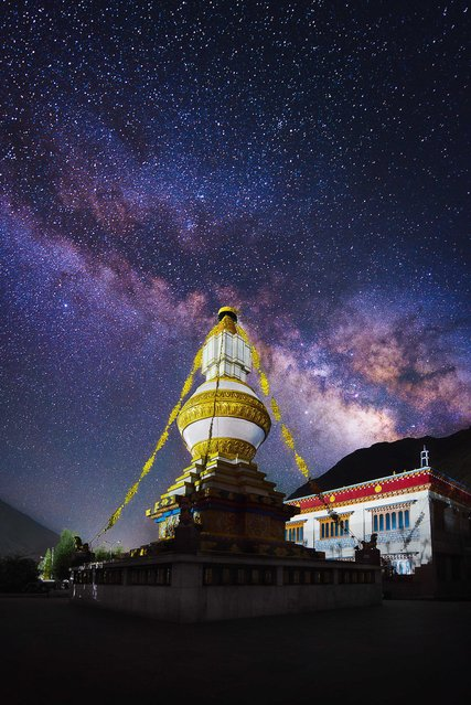 The Tabo Monastery Stupa lit up as the Milky Way is captured above in the Spiti Valley, Himachal Pradesh, northern India. (Photo by Grey Chow/Caters News Agency)