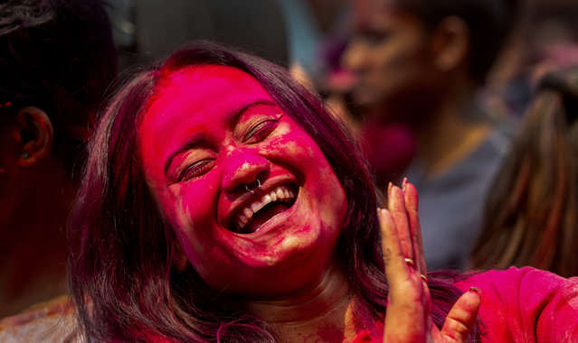 An Indian woman dances during Holi festival celebrations in Gauhati, India, Monday, March 29, 2021. (Photo by Anupam Nath/AP Photo)