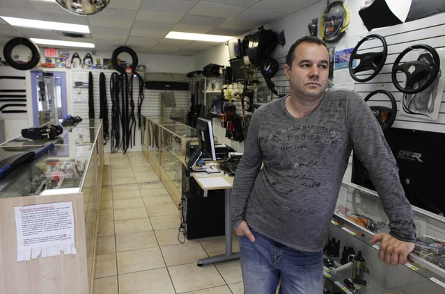 Fabian Zakharov waits for clients in his Zakharov Auto Parts shop, in Hialeah, Florida, February 4, 2015. (Photo by Javier Galeano/Reuters)