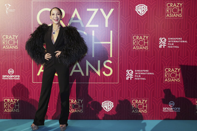 """Actress Fiona Xie poses for photographers as she arrives for the red carpet screening of the movie """"Crazy Rich Asians"""" on Tuesday, August 21, 2018, in Singapore. (Photo by Don Wong/AP Photo)"""