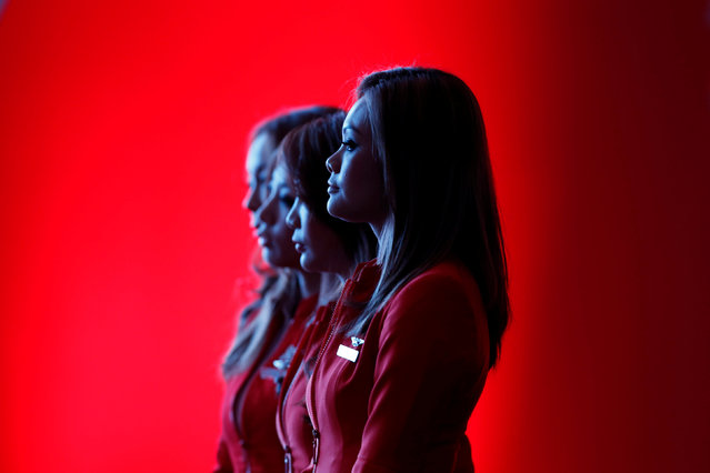 Flight attendants of the long-haul carrier AirAsia X watch a performance during the launch of the company's prospectus in Kuala Lumpur June 10, 2013. (Photo by Bazuki Muhammad/Reuters)