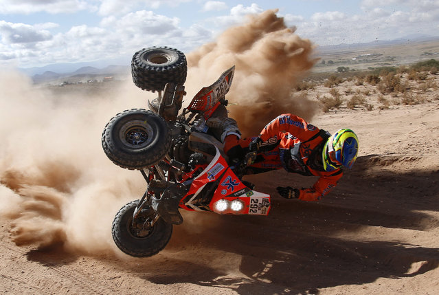 Brazilian Marcelo Medeiros of Yamaha team in an accident during the fifith stage of the Rally Dakar 2016 between Jujuy, Argentina, and Uyuni, Bolivia, 07 January 2016. (Photo by Felipe Trueba/EPA)