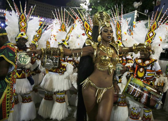 Emperatriz Leopoldinense samba school's drum queen Cris Vianna participates in the annual carnival parade in Rio de Janeiro's Sambadrome, February 17, 2015. (Photo by Pilar Olivares/Reuters)