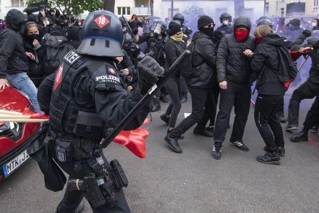 "Police and demonstrators clash during the ""Revolutionary May Day Demonstration"" in Frankfurt on Saturday, May 1, 2021. (Photo by Boris Roessler/dpa via AP Photo)"