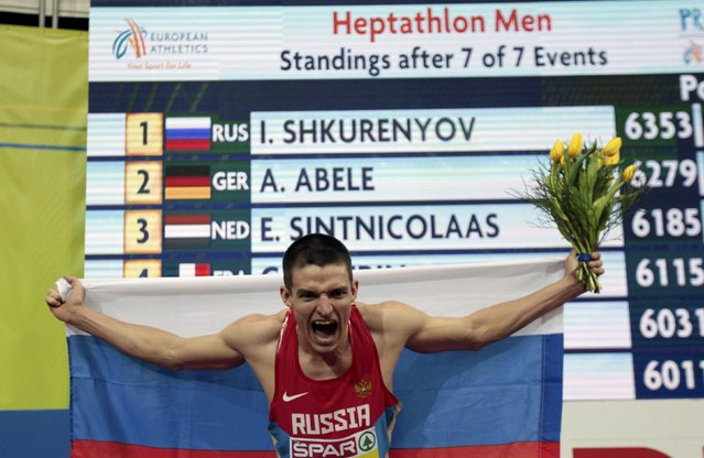 Ilya Shkurenyov of Russia celebrates winning the men's hepthatlon event during the European Indoor Championships in Prague March 8, 2015. REUTERS/David W Cerny (CZECH REPUBLIC  - Tags: SPORT ATHLETICS)