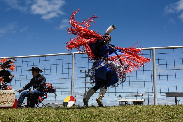 A woman from Dancing Eagles dance troupe from the Osage and Creek tribes performs a dance at an Indian relay race over Memorial Day weekend in Pawhuska, Oklahoma, U.S., May 29, 2021. (Photo by Stephanie Keith/Reuters)
