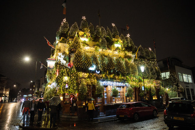 A general view of the Churchill Arms pub in Kensington on December 10, 2016 in London, England. The Churchill Arms has been decorated with 90 conifers and thousands of fairy lights for the Christmas period. (Photo by Jack Taylor/Getty Images)