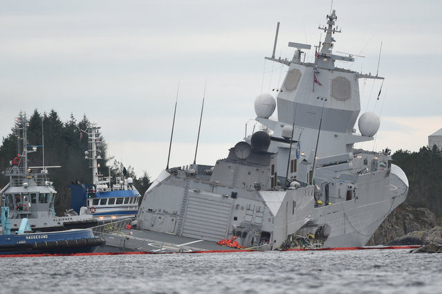 "The Norwegian frigate ""KNM Helge Ingstad"" takes on water after a collision with the tanker ""Sola TS"" in Oygarden, Norway, November 8, 2018. (Photo by Marit Hommedal/NTB Scanpix via Reuters)"