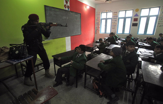 Special combat police conducting an exercise to repel militant attacks enter a classroom at Elizabeth High School in Peshawar, Pakistan January 28, 2016. (Photo by Fayaz Aziz/Reuters)