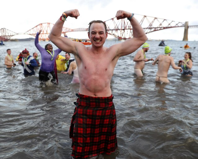 Swimmers participate in the New Year's Day Loony Dook swim at South Queensferry in Scotland, Britain, January 1, 2017. (Photo by Russell Cheyne/Reuters)