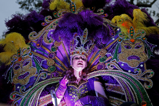 A Maid from the royal court of Endymion throws beads as the Krewe of Endymion Mardi Gras parade rolls through New Orleans, Saturday, February 6, 2016. (Photo by Gerald Herbert/AP Photo)