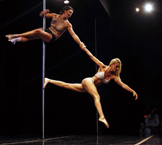 Ekaterina Malykhina and Tallyta Torres of Brazil perform during the doubles category at the Miss Pole Dance South America 2013 competition in Buenos Aires, on November 25, 2013. (Photo by Agustin Marcarian/Reuters)