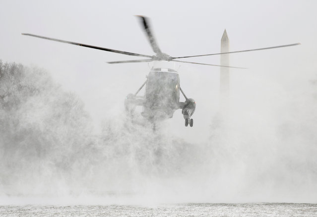 Marine One blows up a cloud of snow as it lands on the South Lawn of the White House in Washington, U.S., January 7, 2017. (Photo by Joshua Roberts/Reuters)