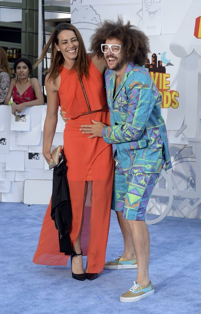 Redfoo and a guest arrive at the 2015 MTV Movie Awards in Los Angeles, California April 12, 2015. (Photo by Phil McCarten/Reuters)