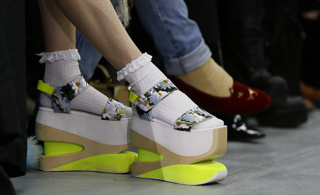 The colourfull shoes of a guest watching the Fyodor Golan Autumn/Winter show at London Fashion Week, Friday, February 19, 2016. (Photo by Kirsty Wigglesworth/AP Photo)