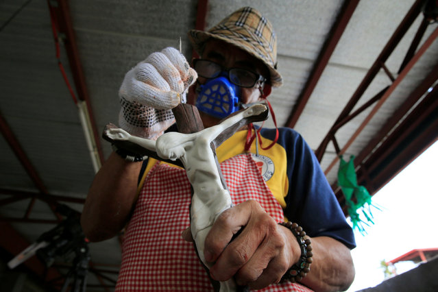 A participant works on a Jesus Christ figurine as part of a drug addiction rehabilitation programme in a Catholic church in Quezon city, metro Manila, Philippines January 14, 2017. (Photo by Romeo Ranoco/Reuters)