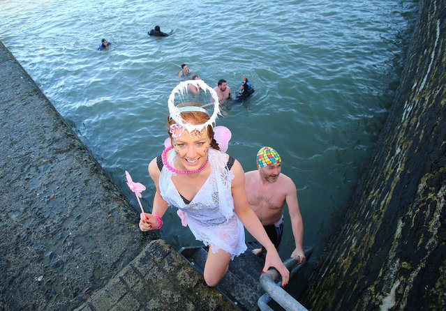 Swim at Slade, Hook Peninsula, Co. Wexford. Pictured at the St. Stephens Day Swim, at Slade, Hook Peninsula, Co. Wexford is Rosanne Gaffney just after the swim, on December 26, 2013. (Photo by Patrick Browne/PA Wire)