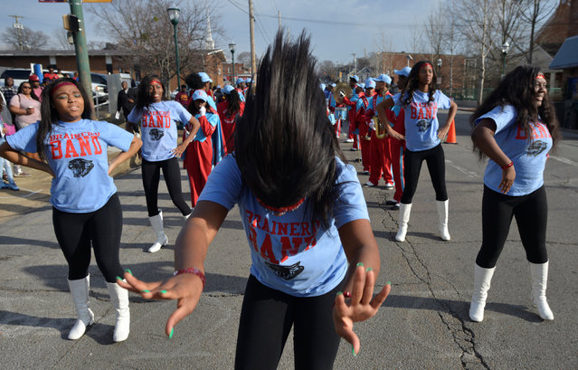 Marki Ash of Brainerd High School's dance team prepares for the annual parade to honor Martin Luther King, in Chattanooga, Tennessee, U.S., January 16, 2017. (Photo by Billy Weeks/Reuters)