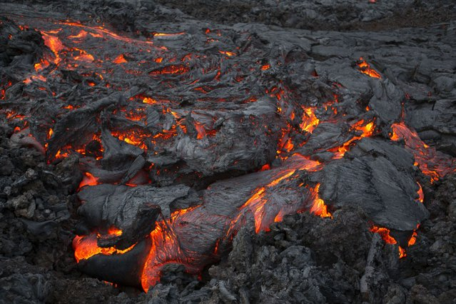 The molten lava from the Plosky Tolbachik volcano. (Photo by Denis Budkov/Caters News)
