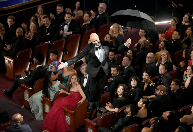 Keegan-Michael Key, one of several guests giving awards in the absence of a host, descends to the floor with an umbrella during the 91st Annual Academy Awards at Dolby Theatre on February 24, 2019 in Hollywood, California. (Photo by Kevin Winter/Getty Images)