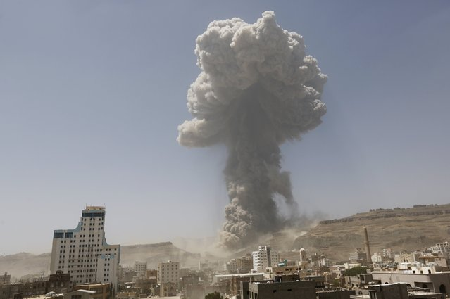 Smoke rises during an air strike on an army weapons depot on a mountain overlooking Yemen's capital Sanaa April 20, 2015. (Photo by Khaled Abdullah/Reuters)
