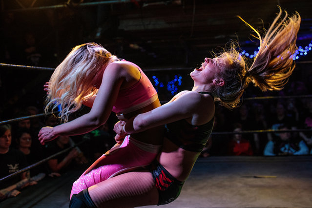 Wrestlers perform during an all-female wrestling event on International Women's Day at the Resistance Gallery in Bethnal Green on March 8, 2019 in London, England. (Photo by Jack Taylor/Getty Images)