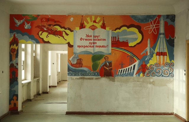 """A text in Russian from Alexander Pushkin's poem """"To Chadaev"""" reads: """"My friend, to our land we dedicate the soul's exquisite raptures!"""" on a mural in the officers' building at the former Soviet military base on January 26, 2017 in Wuensdorf, Germany. (Photo by Sean Gallup/Getty Images)"""