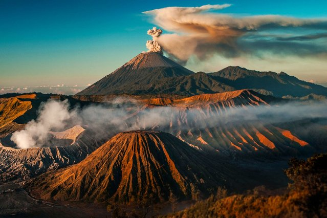 Primeval Tengger Caldera with active volcanoes Bromo in foreground and Semeru in background shortly after sunrise. (Photo by Caters News)