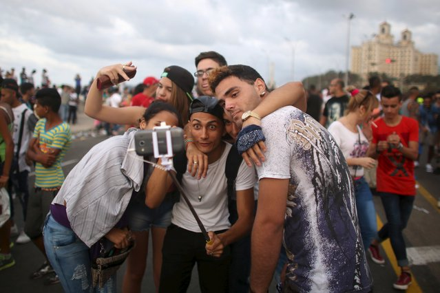 People at the seafront Malecon take a selfie during a performance by U.S. electronic music group Major Lazer in Havana, March 6, 2016. (Photo by Alexandre Meneghini/Reuters)