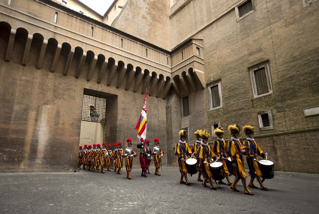 Vatican Swiss guards march after a swearing-in ceremony, at the Vatican, Wednesday, May 6, 2015. (Photo by Alessandra Tarantino/AP Photo)