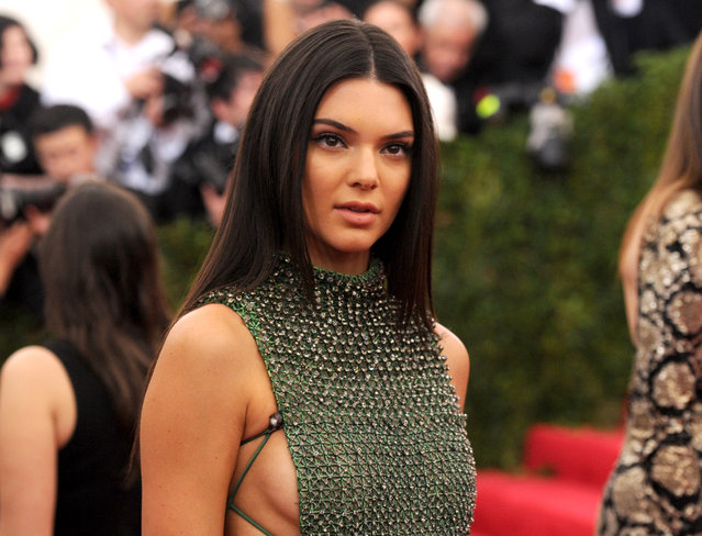 "Kendall Jenner arrives at The Metropolitan Museum of Art's Costume Institute benefit gala celebrating ""China: Through the Looking Glass"" on Monday, May 4, 2015, in New York. (Photo by Evan Agostini/Invision/AP Photo)"