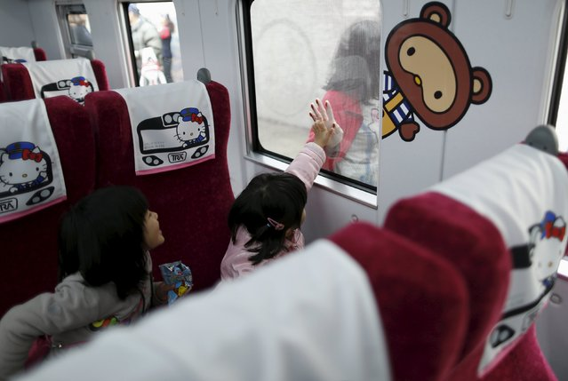 Children react inside a Hello Kitty-themed Taroko Express train in Taipei, Taiwan March 21, 2016. (Photo by Tyrone Siu/Reuters)