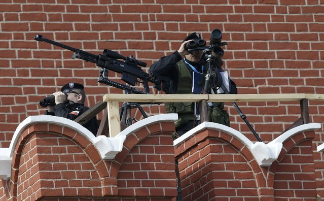Snipers take up a position prior to the Victory Day parade at Red Square in Moscow, Russia, May 9, 2015. (Photo by Sergei Karpukhin/Reuters)