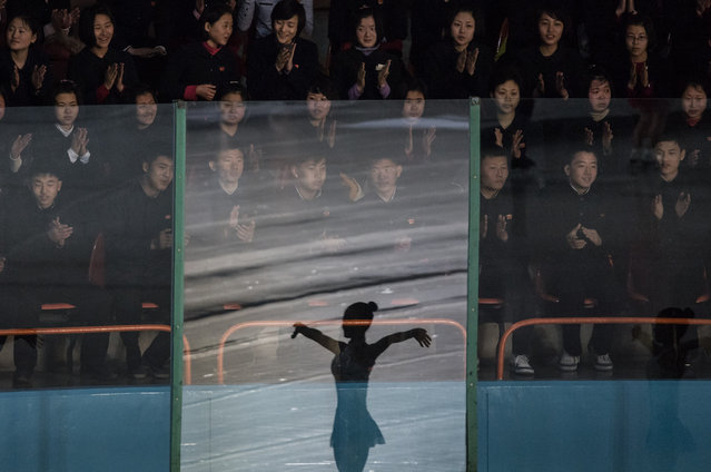 Spectators watch figure skaters perform at the Paektusan Prize International Figure Skating Festival in Pyongyang on February 15, 2017. The Paektusan Prize International Figure Skating Festival is held every year to celebrate Kim Jong-Il, the leader who oversaw the North's first nuclear tests. (Photo by Ed Jones/AFP Photo)
