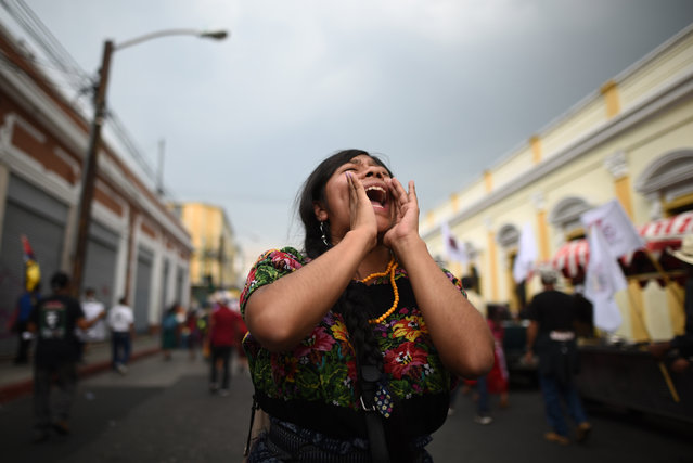 "A woman yells a slogan as hundreds of indigenous people, farmers and activists participate in the ""March of Dignity for Life and Justice"", organized to demand an end to corruption and persecution, in Guatemala City, Guatemala, 08 May 2019. The march left the western city of Quetzaltenango, and continued along the Interamerican highway, then onto the historic center of Guatemala City after traveling about 200 km since 01 May. (Photo by Edwin Bercián/EPA/EFE)"