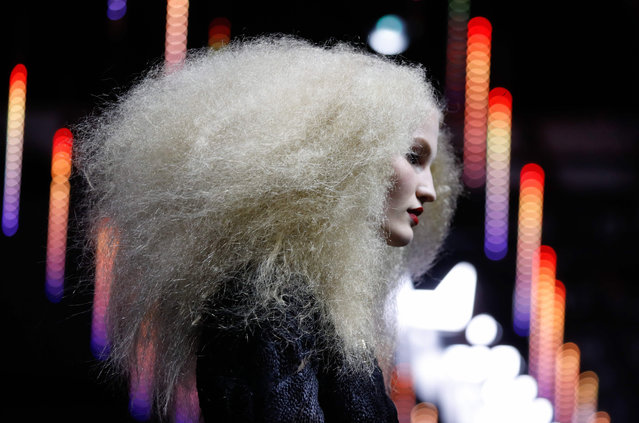 """A model presents a creation for L'Oreal during the """"La French – Art Of Hair Coloring"""" show on March 24, 2019 in Paris. (Photo by François Guillot/AFP Photo)"""