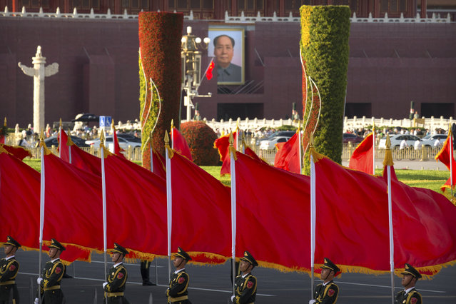 Members of a Chinese honor guard stand in formation near the large portrait of former Chinese leader Mao Zedong on Tiananmen Gate near Tiananmen Square before a welcome ceremony for Niger's President Mahamadou Issoufou at the Great Hall of the People in Beijing, Tuesday, May 28, 2019. (Photo by Mark Schiefelbein/AP Photo)