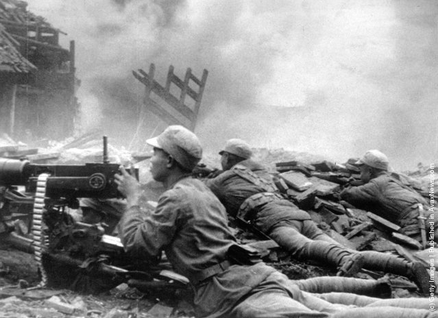 1944: Chinese troops during the Battle of Changteh, the strategic city in the heart of China's rice-growing area. It changed hands four times in forty days
