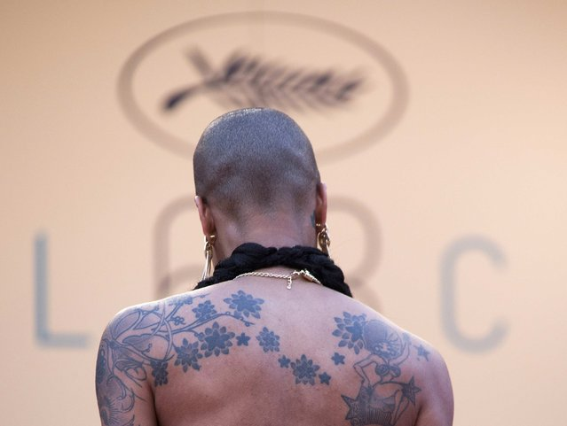 """The tattoo of a guest is pictured as she walks on the red carpet during arrivals for the screening of the film """"Dheepan"""" in competition at the 68th Cannes Film Festival in Cannes, southern France, May 21, 2015. (Photo by Yves Herman/Reuters)"""